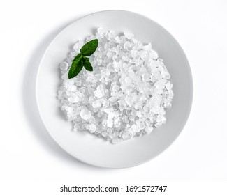 Water kefir also called tibicos grains in a white plate on a white table