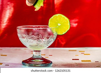 water lamon and hony bee in cristal glass on table with red  background