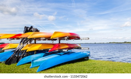 Water landscape with colorful rental canoes in the harbor of  a lake called Leekstermeer in Drenthe in the Netherlands