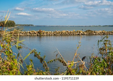 water landscape in Strijensas. View on Moerdijk Bridge and river called Hollands Diep. The Netherlands