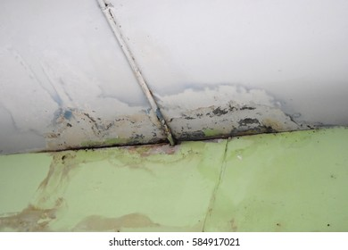 Water leaks on the ceiling causing damage, tiles and cement.