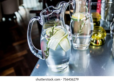 Water with lemon and cucumber in a decanter