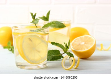 water with lemon on a light background