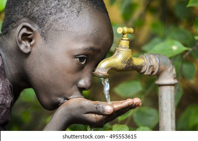Water is Life! African Baby Boy Drinking Water (Drought Symbol)