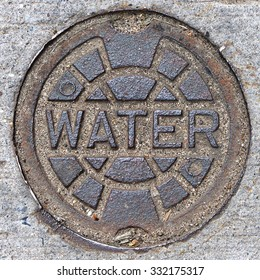 A water main manhole cover in Brooklyn, New York