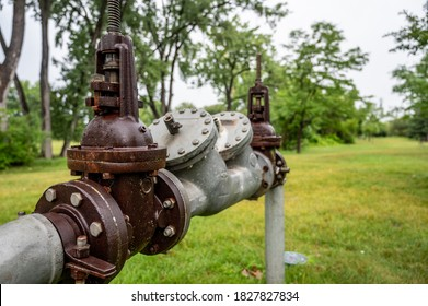 Water main pipe with back flow prevention, double block, and bleed valves
