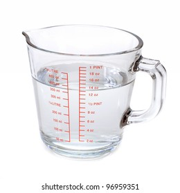 Water in measuring cup on white background
