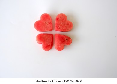 Water melon cut into heart shape.pieces of heart shape watermelon on white background with copyspace. love concept. Valentine's Day Concept.