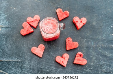 Water melon cut into heart shape. Watermelon smoothie. Flat lay composition. love concept. Valentine's Day Concept