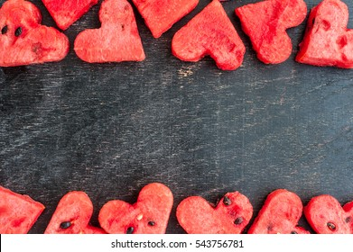 Water melon cut into heart shape. Space for text. Flat lay composition. love concept. Valentine's Day Concept