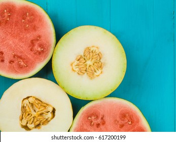 Water Melon Galia Melon and Honeydew Melon Against a Blue Background