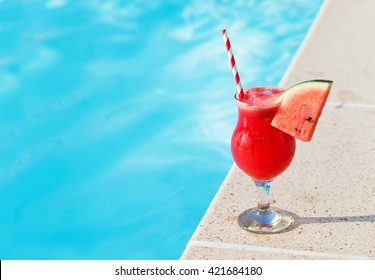 Water melon red fresh juice smoothie drink cocktail near swimming pool