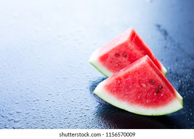 Water melon slices on a black background