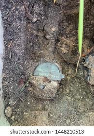 Water meter covered in dirt