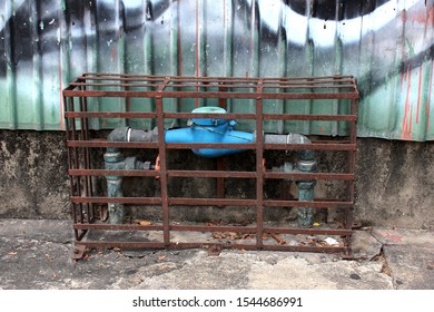 The water meter is covered with steel grilles to prevent theft