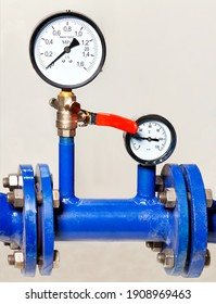 Water metering and pressure system installation, close-up of pressure gauges, pipes and taps, copy space, vertical image.