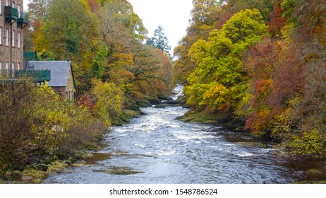 Water mill beside a river surrounded by Aumum trees