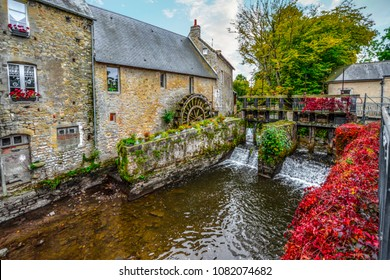 The water mill on the River Aure in the medieval town of Bayeux on the Normandy Coast of France, with bold autumn colors
