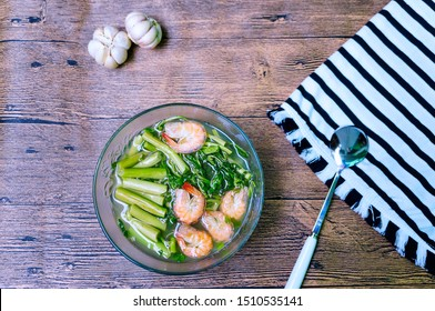 """""""Water Mimosa"""" sour soup, with shrimps and green onion. Vietnamese cuisine. (Vietnamese name of this soup: Canh chua rau nhút)."""