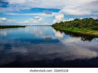 Water mirror in the amazon river, Iquitos, Peru