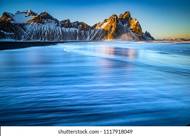 Water moves up the black beach at Vesrahorn, Iceland