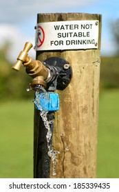 Water not suitable for drinking sign on outdoor  water tap.