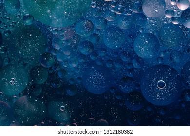 Water oil bubble macro abstract background flow liquid dark blue aqua black colors