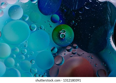 Water oil bubble macro abstract background flow liquid blue pink green colors