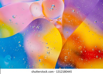 Water oil bubble macro abstract background flow liquid blue aqua yellow pink red colors