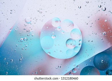 Water oil bubble macro abstract background flow liquid blue pink white aqua colors