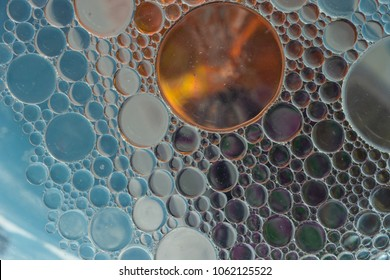 Water oil emulsion to make abstract images using colored backgrounds