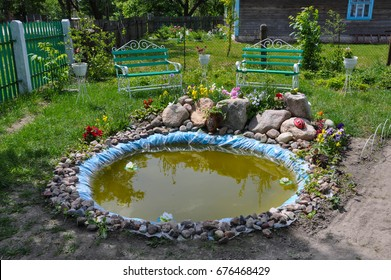 Water. Ornament of the infield. Flower beds.