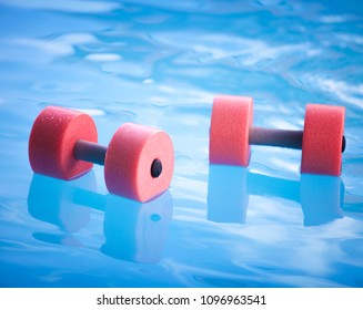 water physiotherapy with dumbbells