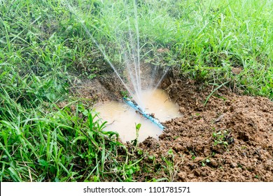 Water pipe break,leaking from hole in a hose  connection joint of plastic pipes Water supply system,selective focus