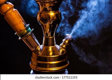 Water pipe hookah with blue smoke