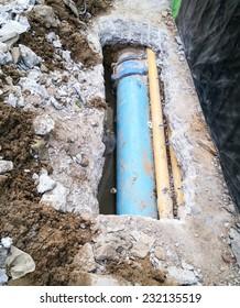 Water pipeline near footpath in the city.