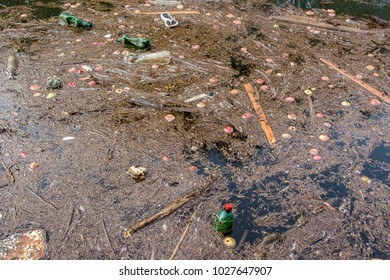 Water pollution in urban areas city plastic bottles