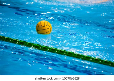 Water polo action in a swimming pool