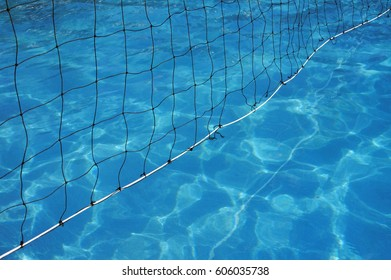 Water Polo net in blue water swimming pool background.