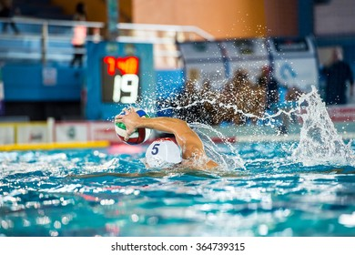 Water polo player launcing  ball in  swimming pool