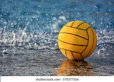 Water polo Yellow ball on sea with splash