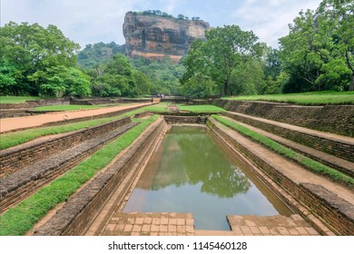 Water pond and landscape of Sigiriya mountain, famous historical and archaeological site. Forest around UNESCO world heritage site.