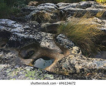 Water ponds in the rocks in the mountains / beautiful wild nature background