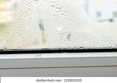 Water pooling from window condensation double glazed windows. Condensation on a plastic window.