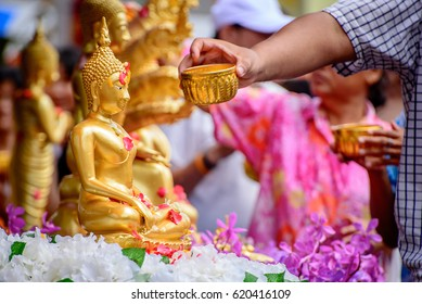water pouring to buddha statue , Songkran festival in thailand