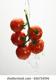 water pouring on a bunch of tomatoes