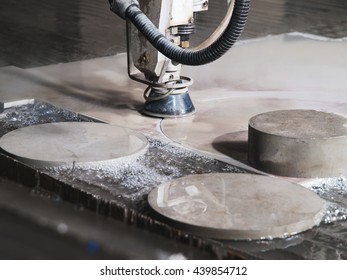 water pressure cutting machine cutting through stainless steel materials