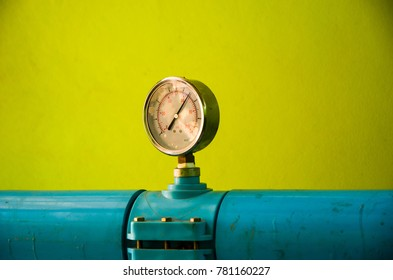 Water pressure gauge in outlet way of water pump piping station on light green background