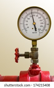 Water pressure meter installed on a red pipe