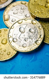 Water price concept with euro currency coins and water drops, vertical studio shot